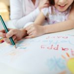close-up-of-girl-painting-with-a-crayon_1098-698