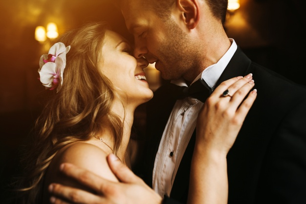 newlyweds-looking-at-each-other-s-face-and-smiling_1153-1310