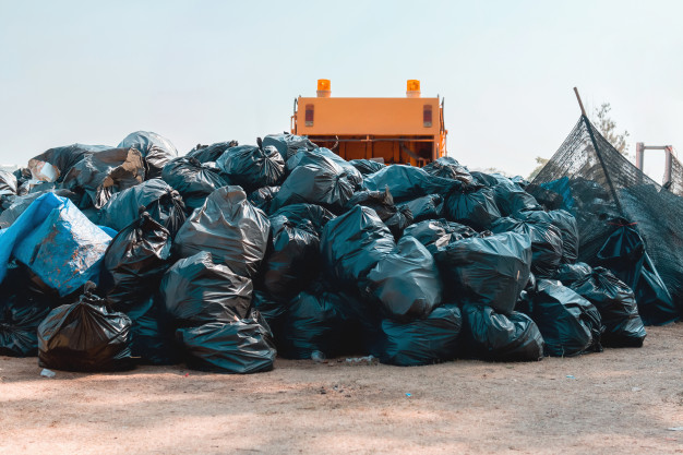 group-garbage-bag-stack-park-recycle_34152-1310