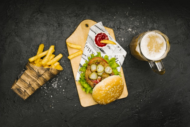 flat-lay-burger-wooden-board-with-fries-beer_23-2148238483